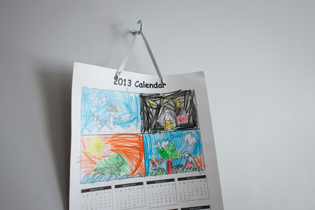 organised: Childhood drawings on calendar hanging on wall LANG_EVOIMAGES