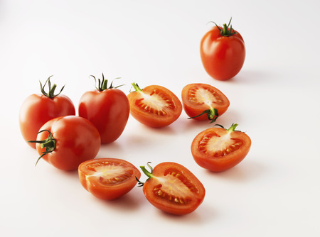 close up food: Halved plum tomatoes on kitchen counter