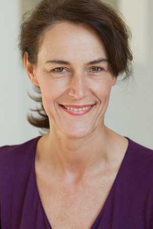off shoulder: Portrait of woman wearing purple top