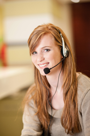 hands free device: Businesswoman wearing headset in office