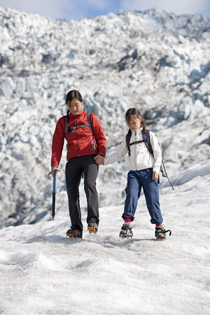 warned: Mother and daughter walking on glacier