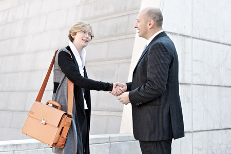 decide deciding: Businesswoman and man shaking hands