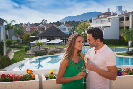 honeymooner: Young couple at holiday resort with champagne