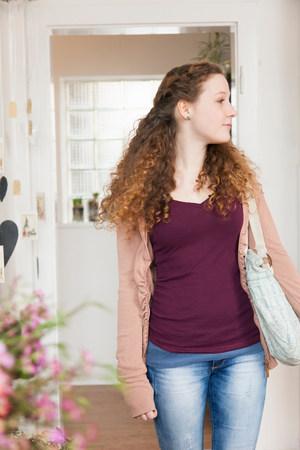 purples: Teenage girl looking around in florists