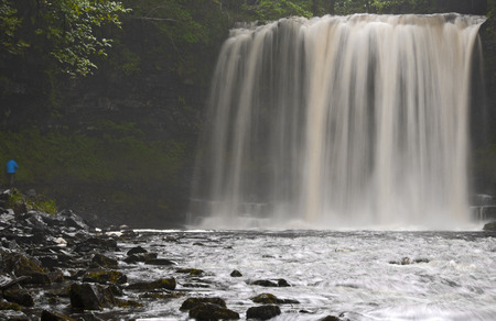 remoteness: Time lapse view of waterfall in forest LANG_EVOIMAGES