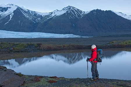 mirroring: Woman hiking near lake,Skaftafell national park,Iceland