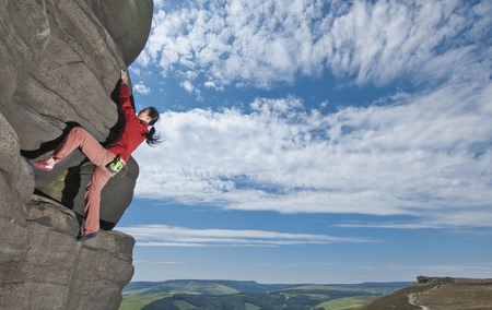 perilous: Rock climber scaling rock formation