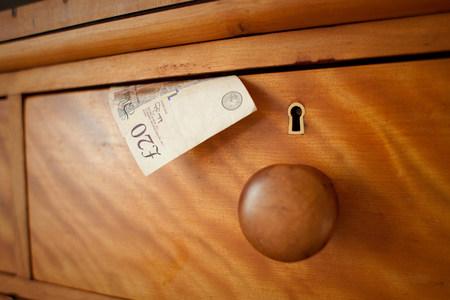 housing lot: Twenty pound note in drawer,close up