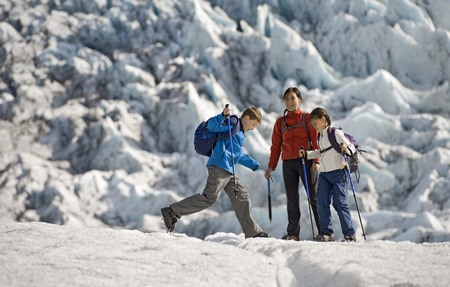 intersecting: Family walking on glacier LANG_EVOIMAGES