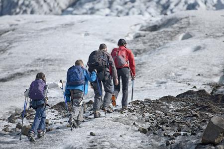 pursuing: Family walking on glacier LANG_EVOIMAGES