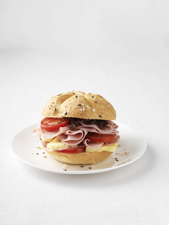 uncomplicated: Ham and tomato sandwich on plate