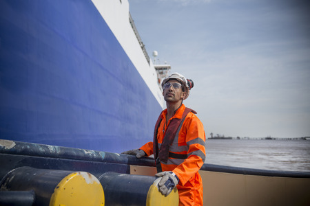 shipped: Worker standing on tug boat