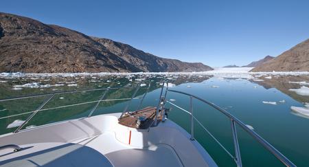 Boat sailing in still glacial lake