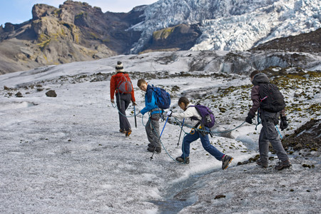 climbed: Family walking on glacier LANG_EVOIMAGES