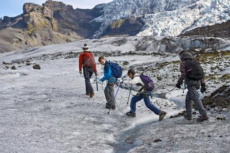 pursued: Family walking on glacier LANG_EVOIMAGES