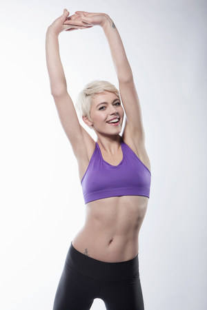 energy work: Woman exercising with arms up