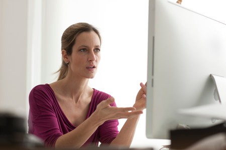 Frustrated woman using computer