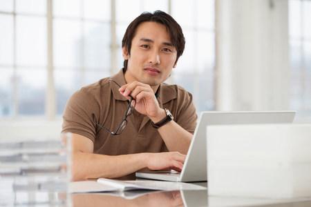 technology: Businessman sitting at desk working