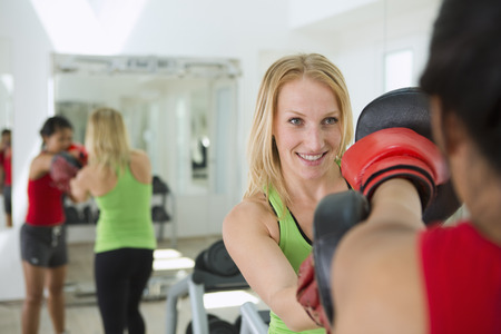 energy work: Trainer working with boxer in gym LANG_EVOIMAGES