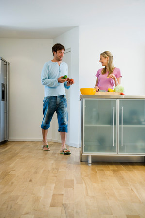 Happy young couple in kitchen