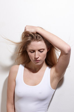 fed up: Woman with arms over head LANG_EVOIMAGES