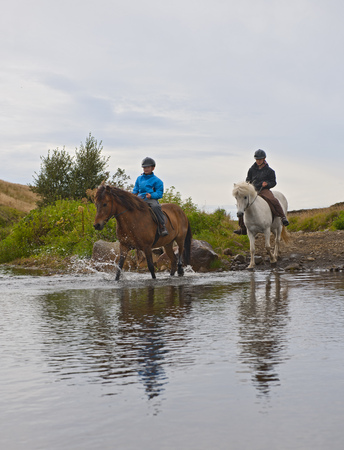 guts: Boys riding horses through creek LANG_EVOIMAGES