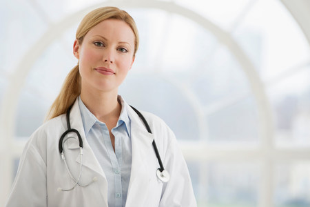 authoritative woman: Portrait of female doctor with stethoscope LANG_EVOIMAGES