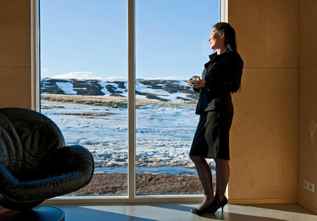 ponderous: Woman looking at view through window from chalet