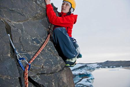 trouble free: Woman rock climbing,Svinafellsjokull glacier,Skaftafell national park,Iceland