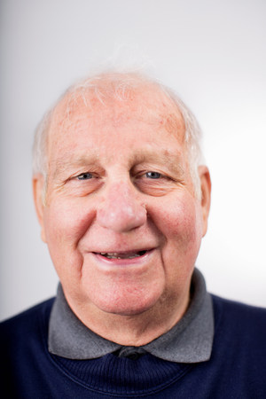 silliness: Portrait of senior man smiling,studio shot