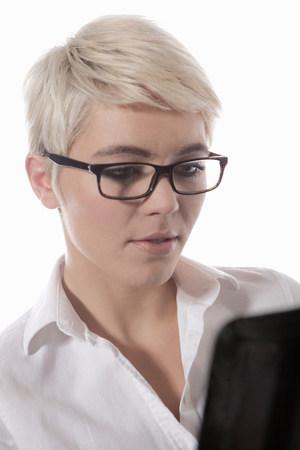 ponderous: Woman wearing glasses using digital tablet LANG_EVOIMAGES