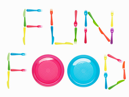 writing utensil: FUN FOOD written with plastic cutlery and plates LANG_EVOIMAGES