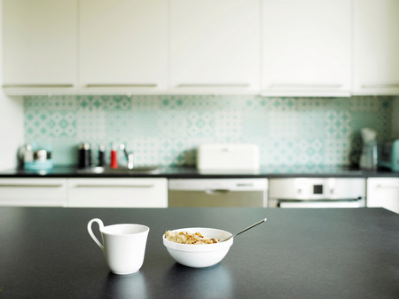 worktops: Breakfast of tea and cereal on kitchen counter