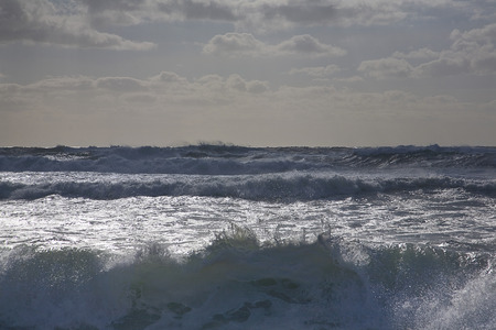 stormy waters: Rocky waves crashing on beach LANG_EVOIMAGES