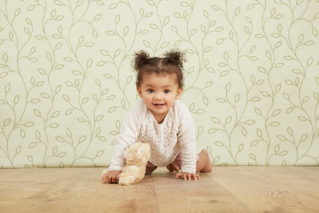 0 1 years: Portrait of baby girl taking crawling