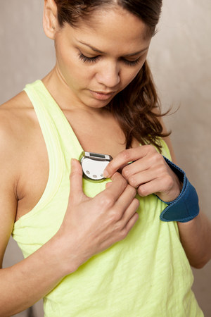 above 18: Young woman using stopwatch