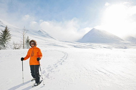 Woman wearing snow shoes,Skidadalur,Dalvik,Iceland LANG_EVOIMAGES