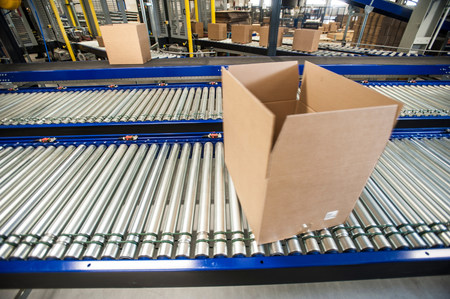 empty warehouse: Empty box on moving conveyor belt