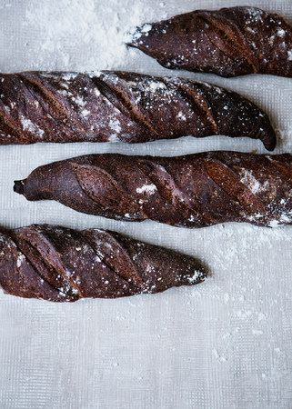 four objects: Homemade baguette with malt