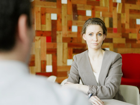 Portrait of mid adult businesswoman in meeting