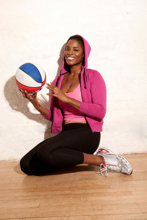 sleeveless hoodie: Young woman holding basketball LANG_EVOIMAGES