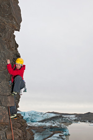 Woman rock climbing,Svinafellsjokull glacier,Skaftafell national park,Iceland