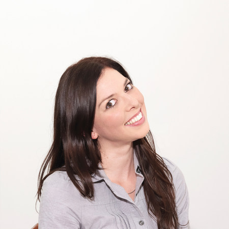 trashy: Portrait of young woman smiling against white background