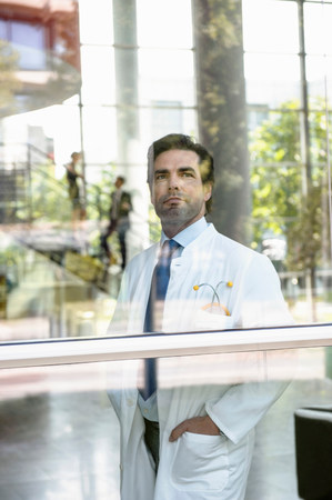 Portrait of male doctor looking out of window