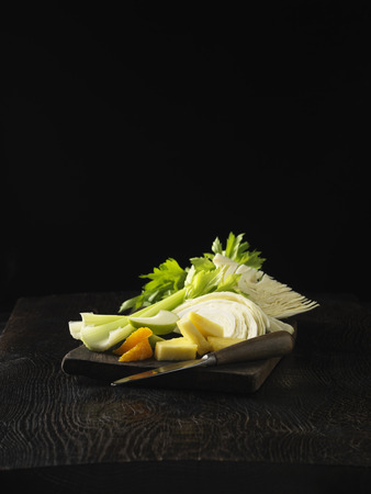 uncomplicated: Plate of celery,orange,and cabbage