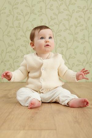 floorboards: Baby girl in sitting on floor