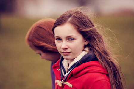 Portrait of girl walking with friend outdoors