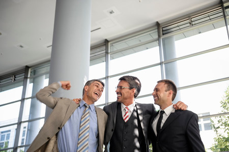 35 to 40 year olds: Three businessmen smiling and celebrating LANG_EVOIMAGES