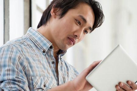 Casual businessman using digital tablet
