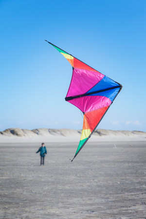 Boy flying kite on beach